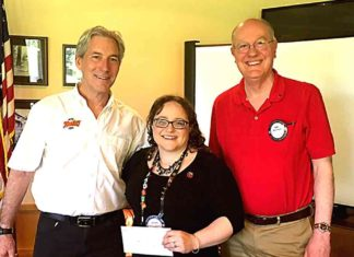 Daniel Lacy (left) accepts Tualatin Rotary Club Legacy Grant from Jessica Cousineau and Mike Bunce.