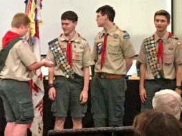 Mason Lewellan presents three Eagle Scouts earn their Silver Palms (recognition for leadership beyond the Eagle Scout rank): Matthew Dannemiller, Liam Davis, and Devin Boatsman.