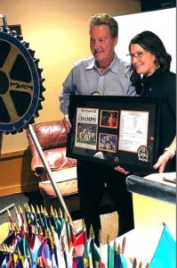 Rotary member Rick Matthias (left) with Michele Schnabel.