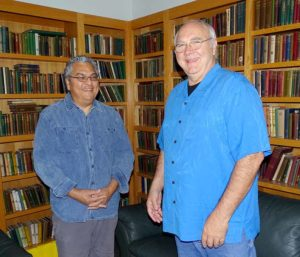 "Basics Market Chuck Eggert and President Fernando Divina, at the company's Teton Avenue headquarters in Tualatin. Their office is in what Divina refers to as ""Chuck's elaborate and massive library"" filled with hundreds of books on farming, some of which are 150 years old."