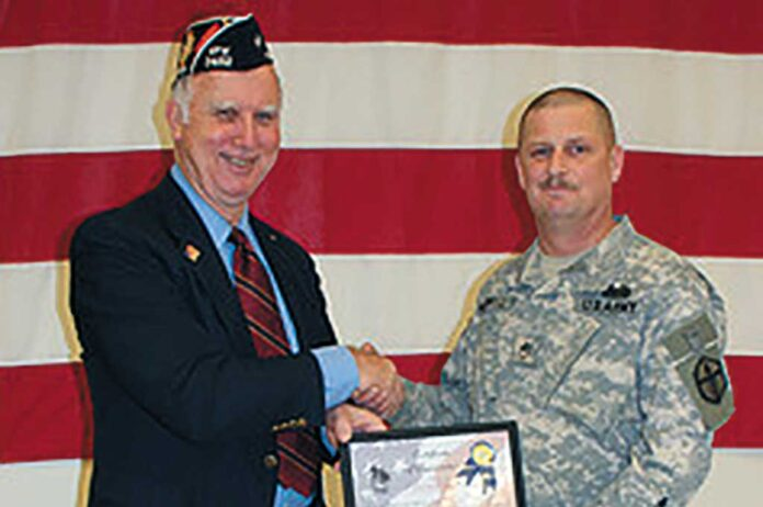 Past Commander Dale Potts accepts certificate from SSG Anthony McDowell.