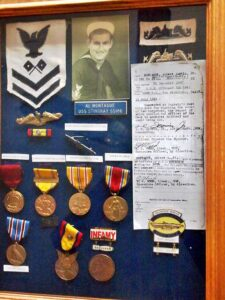 Picture of a much younger looking Monty is in the top portion of the above shadow box holding his military medals.