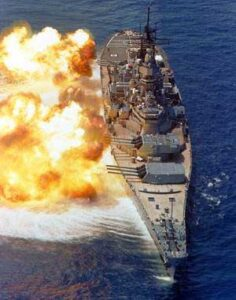USS Iowa (BB-61) fires her 16-inch/50-calibur guns.
