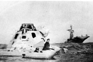 From Yorktown Crier - ship's newspaper - Apollo capsule being prepared to be lifted aboard Yorktown.